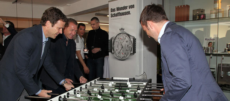 Oliver Bierhoff, Andreas Koepke, and goalkeeping coach Hans-Dieter Flick are playing table soccer