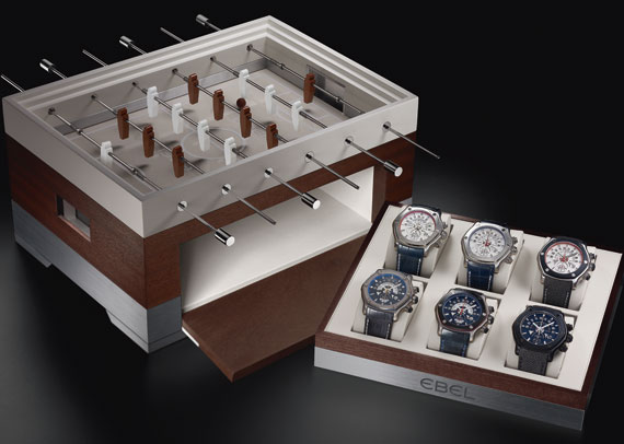 Ebel presents all six of its 1911 Tekton limited editions, in association with Arsenal, Glasgow Rangers, Bayern Munich, AFC Ajax, Olympique Lyonnais and Real Madrid, in a box set in the shape of a table football game © Ebel